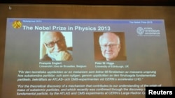 Images of Francois Englert of Belgium and Britain's Peter Higgs, laureates of the 2013 Nobel Prize in Physics, are displayed on a screen during a news conference at the Royal Swedish Academy of Sciences in Stockholm October 8, 2013. Higgs and Englert won