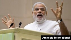 FILE - Indian Prime Minister Narendra Modi speaks during conference by The Environment Ministry, New Delhi, April 6, 2015.