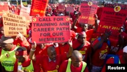 Members of the National Union of Metal Workers of South Africa (NUMSA) protest on the streets of Durban, July 1, 2014.