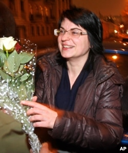 Natalya Radina, editor-in-chief of the Charter97 website, gets flowers from her friends as she was released from prison in the capital Minsk, Belarus, Jan. 28, 2011.
