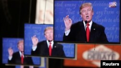 Republican U.S. presidential nominee Donald Trump is shown on TV monitors in the media filing room on the campus of University of Nevada, Las Vegas, during the last 2016 U.S. presidential debate in Las Vegas, U.S., Oct. 19, 2016.