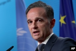 FILE - German Foreign Minister Heiko Maas addresses the media in Berlin, Dec. 17, 2020.