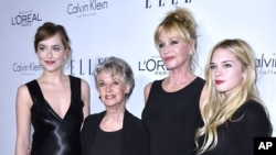 From left: Dakota Johnson, Tippy Hedren, Melanie Griffith and Stella Banderas attend the 2015 ELLE Women in Hollywood Awards at the Four Seasons Hotel in Los Angeles, Oct. 19, 2015.