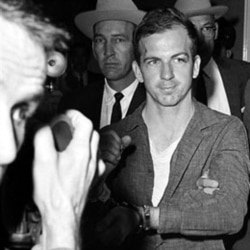 Lee Harvey Oswald at police headquarters in Dallas