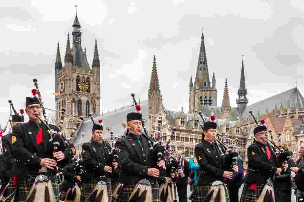 Bagpipers with the Scots regiment perform as they march from the Belfort towards the Menin Gate during an Armistice Day ceremony in Ypres, Belgium. The Menin Gate Memorial bears the names of more than 54,000 British and Commonwealth soldiers who were killed in the Ypres Salient of World War I and whose graves are not known.