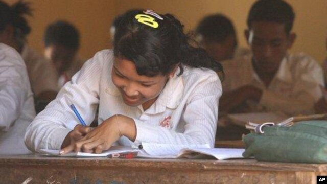 A girl sits in a history class at the local high school in, Cambodia.