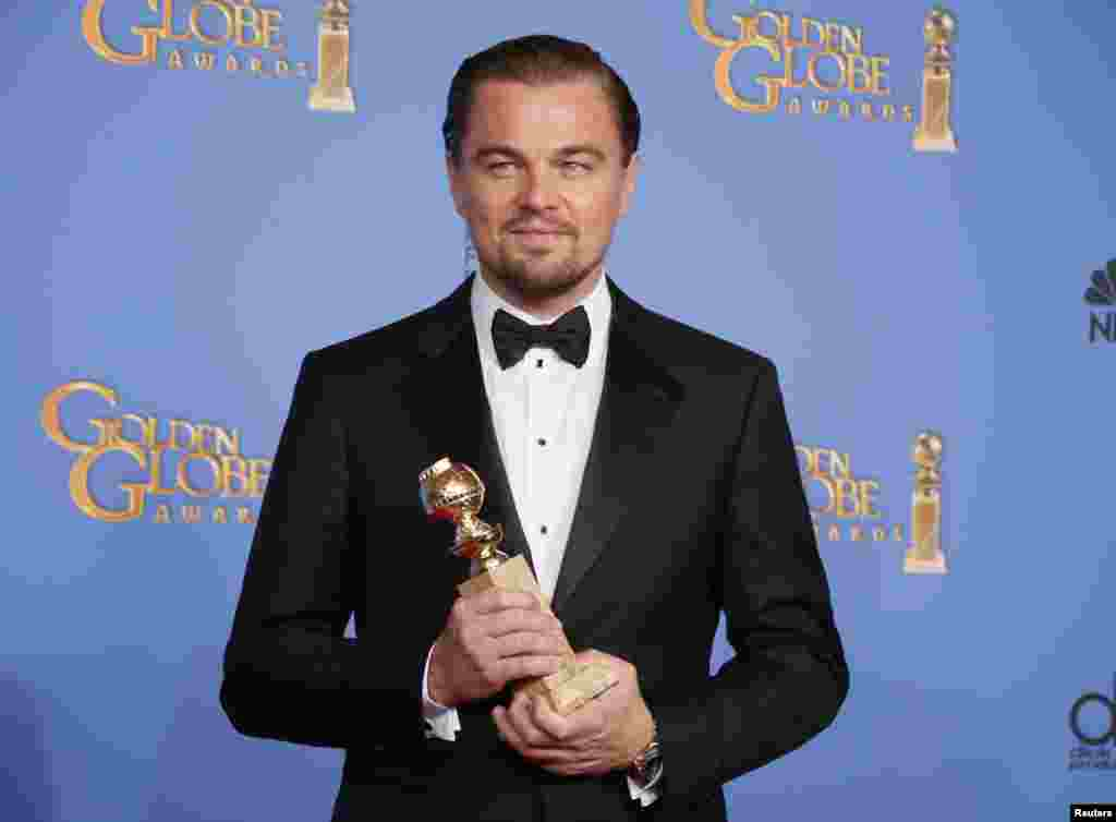 "Leonardo DiCaprio poses with the award for Best Actor in a Motion Picture, Musical or Comedy for his role in ""The Wolf of Wall Street"" at the Golden Globe Awards in Beverly Hills, California, Jan. 12, 2014."