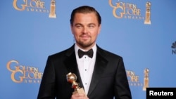 "Actor Leonardo DiCaprio poses with the award for Best Actor in a Motion Picture, Musical or Comedy for his role in ""The Wolf of Wall Street"" backstage at the 71st annual Golden Globe Awards in Beverly Hills, California, Jan. 12, 2014."