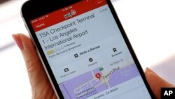 The mobile view of the Yelp site application shown on an iPhone mobile, shows the TSA Checkpoint Terminal 1 at the Los Angeles International Terminal location in Los Angeles, Aug. 18, 2015.
