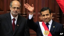 Peru's newly sworn in President Ollanta Humala , right, waves during his ceremonial swearing in at the National Congress in Lima, Peru, Thursday, July 28, 2011