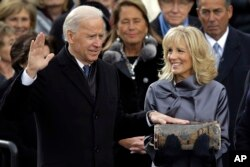 Jill Biden looks at her husband Vice President Joe Biden as he sworn-in at the ceremonial swearing-in at the U.S. Capitol during the 57th Presidential Inauguration in Washington, Monday, Jan. 21, 2013. (AP Photo/Carolyn Kaster)