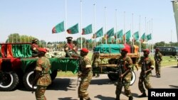 FILE: Flags fly at half mast as the funeral cortege for the late Zambian President Michael Sata arrives for a memorial service in the capital Lusaka, Zambia, Nov. 10, 2014.