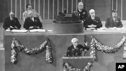 File - Joseph Paul Boncour of France, center, addresses the final session of the United Nations conference after the creation of its charter, as U.S. President Harry S. Truman, second from top left, and U.S. Secretary of State Edward R. Stettinius, second