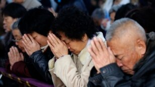 FILE - Believers take part in a weekend mass at an underground Catholic church in Tianjin, China, Nov. 10, 2013. China once again has been designated by the U.S. Commission on International Religious Freedom as a country of particular concern.