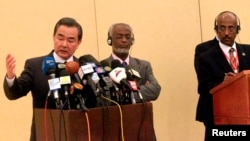 Chinese Foreign Minister Wang Yi (L), Tedros Adhanom, former Ethiopia's Foreign Minister, and Chair of the IGAD Council of Ministers and Sudan's Foreign Minister Ali Karti (C) after a meeting to support the Intergovernmental Authority on Development (IGAD)-led South Sudan peace process in Khartoum January 12, 2015.