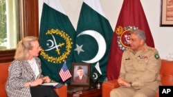 Alice Wells, U.S. deputy assistant secretary of state, meets with Pakistani army chief Gen. Qamar Javed Bajwa to discuss how to ensure peace in Afghanistan following a recent cease-fire between the Taliban and Kabul, in Rawalpindi, Pakistan, July 3, 2018.