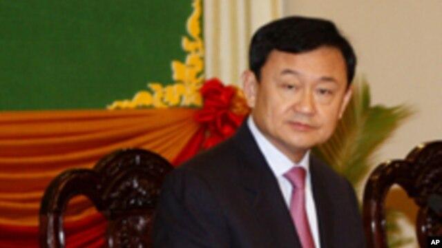 FILE - Thaksin Shinawatra, former Thai prime minister, Sept. 17, 2011.