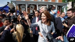 Rep. Michele Bachmann, R-Minn., waves to supporters after making her formal announcement to seek the 2012 Republican presidential nomination in Waterloo, Iowa. Bachmann, who was born in Waterloo, will continue her announcement tour this week with stops in
