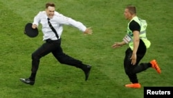 FILE PHOTO: On July 15, 2018, Pitch invader Pyotr Verzilov is chased by a steward during the World Cup final between France and Croatia.