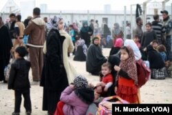 "Families say IS militants are stealing civilians' ID cards, a move that convinces some people to stay inside IS territories and unwittingly serve as ""human shields,"" March 29, 2017, in Hammam Alil, Iraq."