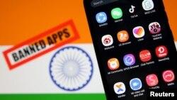 印度国旗上的一只手机上被禁的中国开发的移动应用产品标识。(2020年7月2日)