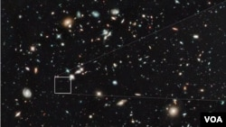The farthest and one of the very earliest galaxies ever seen in the universe appears as a faint red blob in this ultra-deep–field exposure taken with NASA's Hubble Space Telescope. This is the deepest infrared image taken of the universe. Based on the obj