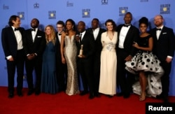 "FILE - The cast and crew of ""Moonlight"" pose backstage with their award for Best Motion Picture - Drama at the 74th Annual Golden Globe Awards in Beverly Hills, Calif., Jan. 8, 2017."
