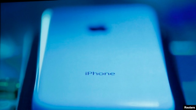 The new iPhone 5C is seen on screen at Apple Inc's media event in Cupertino, California Sept 10, 2013.