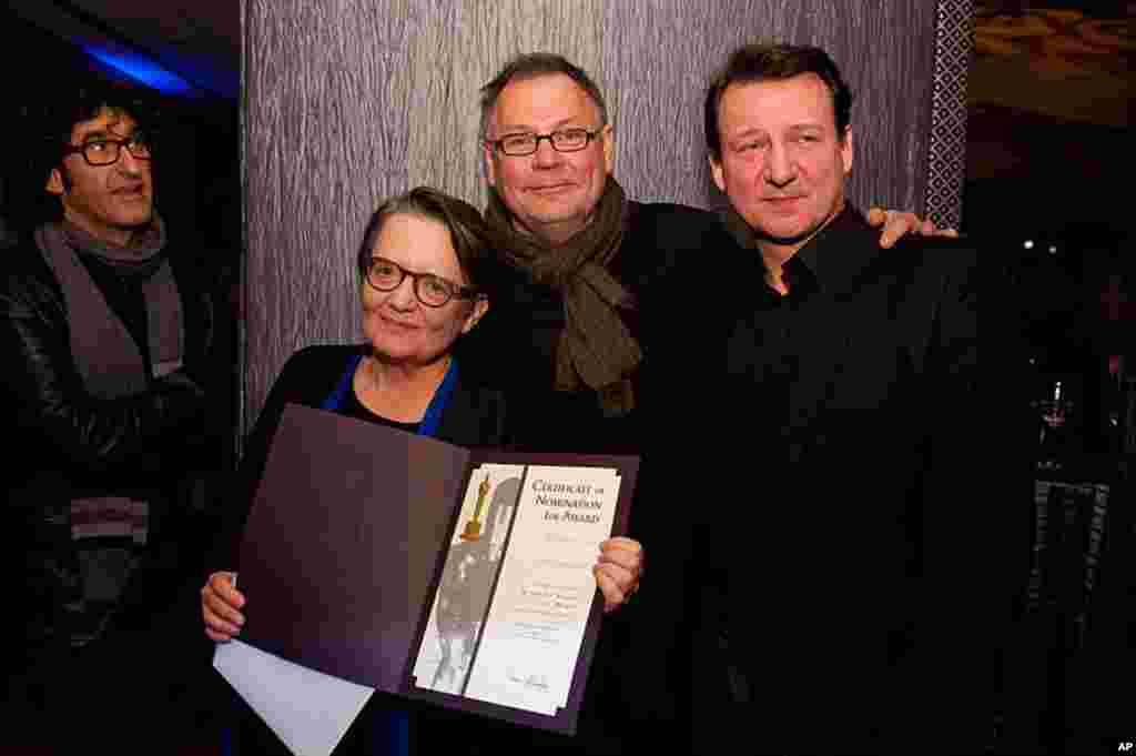 """Agnieszka Holland, """"In Darkness"""" (left), accepts her certificate of nomination for the 84th Academy Awards from Janusz Kaminski (center) at a Foreign Language Film Award reception held in the Grand Lobby of the Samuel Goldwyn Theater in Beverly Hills, CA"""