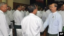 Burmese President Thein Sein, right, greets fellow Union Solidarity and Development Party members, Naypyitaw, Oct. 14, 2012.