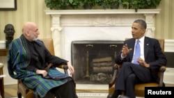 美国总统奥巴马1月11日在白宫会晤阿富汗总统卡尔扎伊