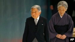FILE - Japan's Emperor Akihito, accompanied by Empress Michiko, leaves after delivering his remarks during a memorial service at Nippon Budokan martial arts hall in Tokyo.