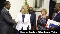 FILE: President Emmerson Mnangagwa and Foreign Affairs Minister SIbusiso Moyo with some British officials in Harare