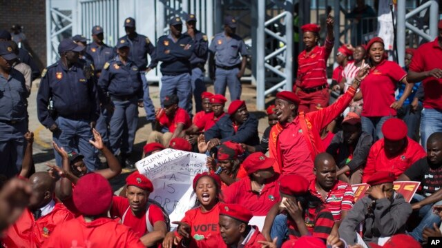 Supporters of Julius Malema's opposition Economic Freedom Fighters (EFF) party who were upset with the election results stage a protest outside the provincial results center for Gauteng province in Johannesburg, South Africa Friday, May 9, 2014. Vote-coun