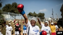 "The ""Boxing Gogos"" (Grannies) stretch as they take part in a session hosted by the ""A Team Gym"" in Cosmo City in Johannesburg on September 19, 2017."