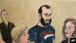 In this courtroom sketch, Agron Hasbajrami, center, is arraigned on a charge of providing material support to terrorists Friday, Sept. 9, 2011 in Brooklyn Federal Court in New York. The government alleges that since 2010, Hasbajrami, an Albanian citizen a