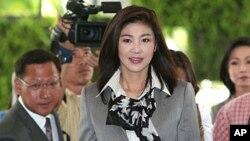 Thủ tướng Thái Lan Yingluck Shinawatra. Người biểu tình yêu cầu bà Yingluck bước ra nhận kiến nghị và nghe những đòi hỏi của họ, nhưng bà không xuất hiện