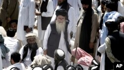 FILE - Pakistan's hard-line cleric Sufi Muhammad, center, arrives to address his supporters in Mingora capital, Swat Valley, April 19, 2009.