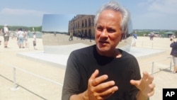 FILE - Artist Anish Kapoor answers questions during an interview with the Associated Press near Paris, June 5, 2015.