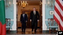 Secretary of State Mike Pompeo, right, arrives with Maldives Foreign Minister Abdulla Shahid, Wednesday, Feb. 20, 2019, at the Department of State in Washington.