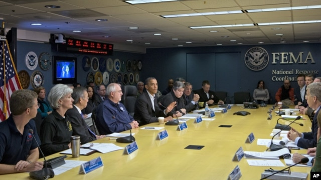President Barack Obama visits the Federal Emergency Management Agency (FEMA) in Washington for an update on the recovery from Hurricane Sandy that hit New York and New Jersey especially hard earlier this week, November 3, 2012.
