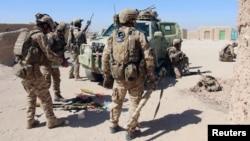 ພາບບັນທຶກ ກຳລັງພິເສດຂອງ ອັຟການິສຖານຕຽມທຳການສູ້ລົບກັບກຸ່ມ Taliban ຢູ່ນອກເມືອງ Lashkar Gah ເມືອງຫລວງຂອງແຂວງ Helmand.