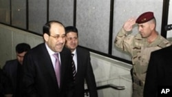 Iraqi Prime Minister Nouri al- Maliki, left, arrives to attend the Iraqi parliament session in Baghdad, Iraq, Monday, Dec. 20, 2010
