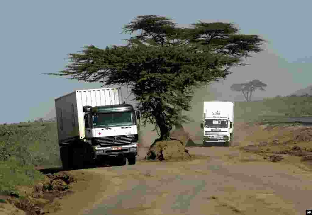 KENYA: Many African roads are seasonably impassable or in bad repair. A Red Cross truck travels on a dirt road, Monday, Feb. 12, 2007, outside the Kenyan town of Naivasha. Harvest losses are high due to poor roads. AP File photo.