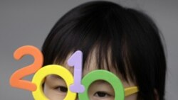 A child wears toy glasses at the Shanghai World Expo in April