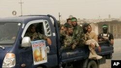 Milicianos chiítas patrullan la ciudad de Samarra, 95 kilómetros al norte de Bagdad.