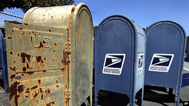 US Postal Service mailboxes are seen awaiting disposal September 1, 2011, in San Jose, California.