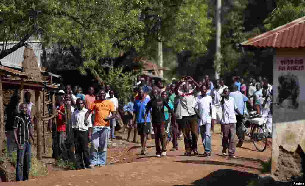 Demonstrators chant slogans in Kenya's western town of Kisumu, 350km (218 miles) from the capital Nairobi as tension arises after Uhuru Kenyatta was declared winner of presidential election, Mar. 9, 2013.