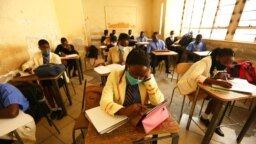FILE - Pupils attend a class at a school in Harare, Sept, 28, 2020. This school year, Zimbabwe in-person classes resumed the week of August 30, 2021, but thousands of teachers are on strike.