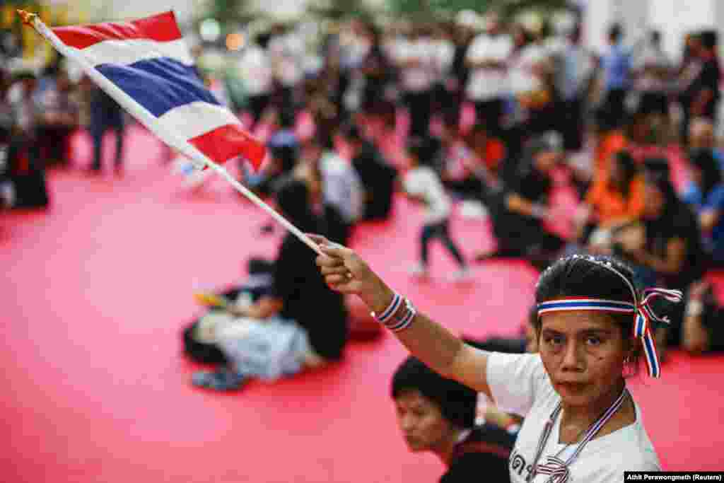 An anti-government protester inside a government complex in Bangkok